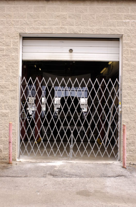 Call Us For A FREE Folding Scissor Security Gate Quote
